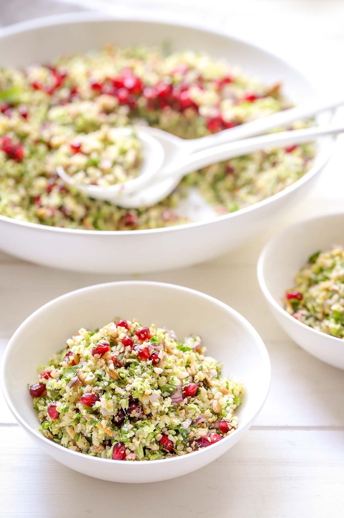 Broccoli Tabbouleh with Toasted Nuts served into bowls