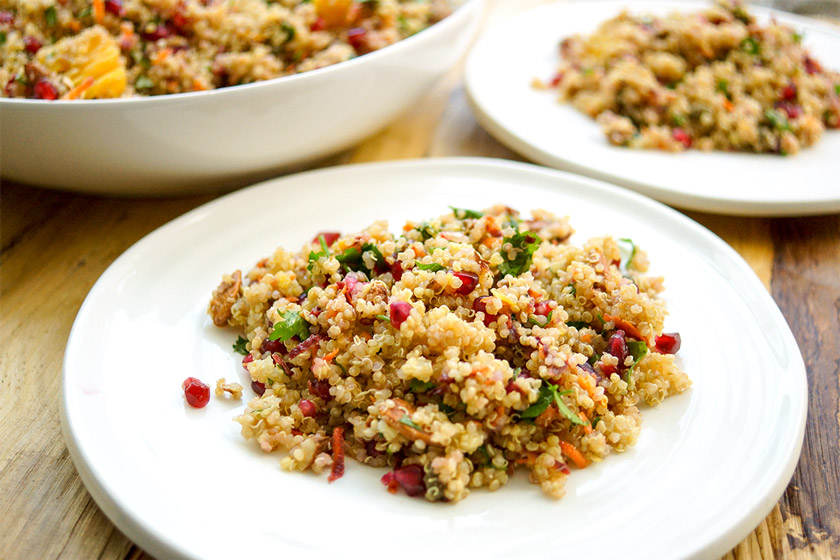 Moroccan-Style Quinoa Salad with oranges, pomegranate, almonds, mint, parsley and capers. Vegan and Gluten-free
