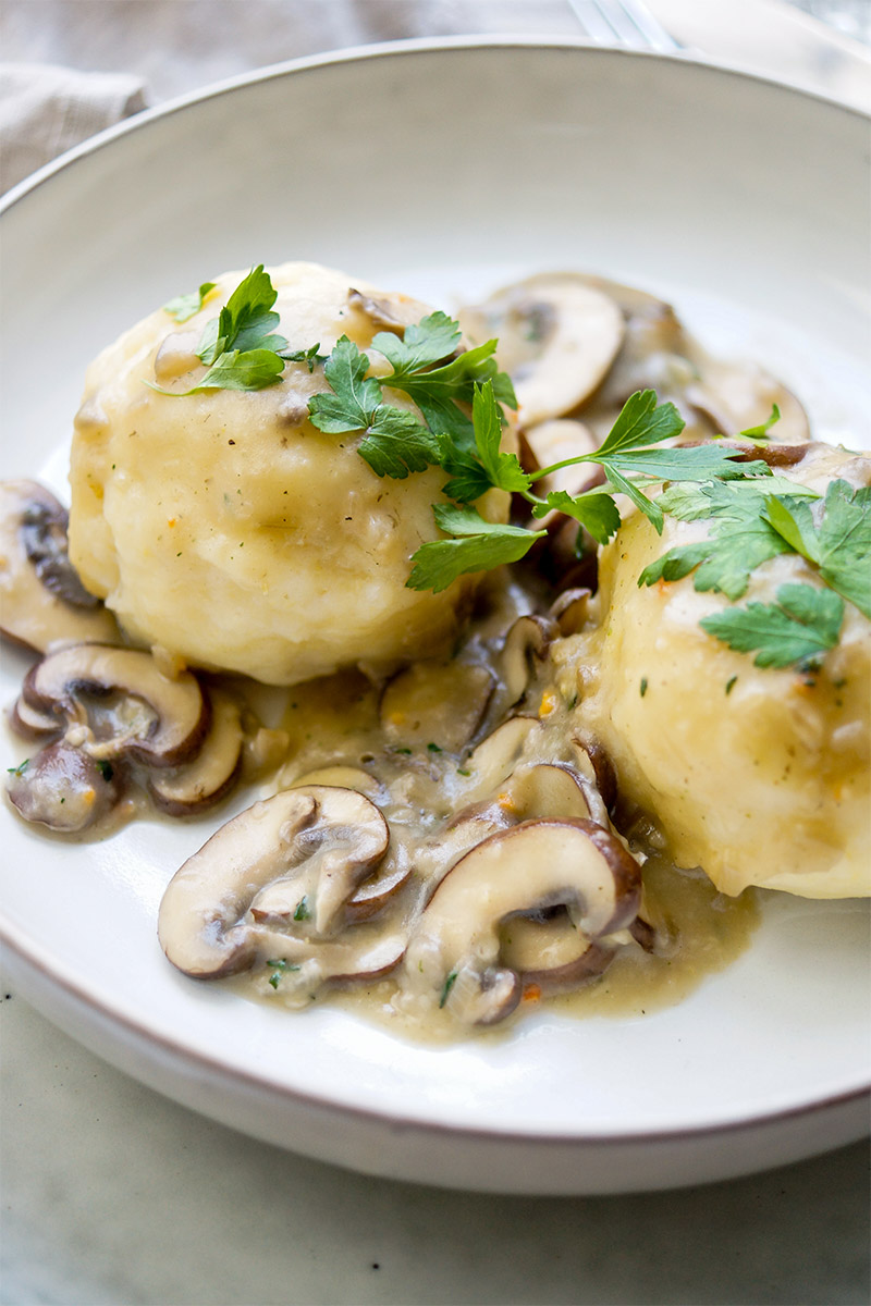 Kartoffelknoedel (German potato dumplings) with mushroom gravy, vegetarian recipe