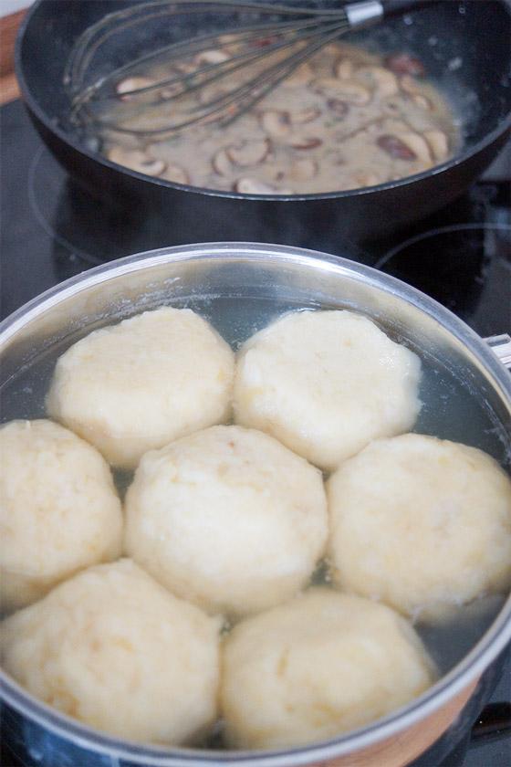Boiling Kartoffelknödel and mushrooms sauce