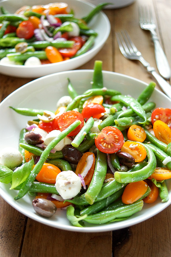 green bean and cherry tomato salad with capers, olives, anchovies, mozzarella, red onion