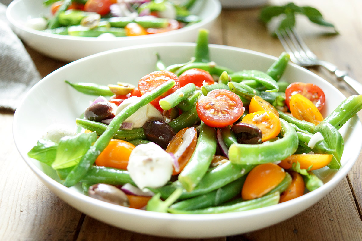 green bean and cherry tomato salad recipe with capers, olives, anchovies, mozzarella, red onion