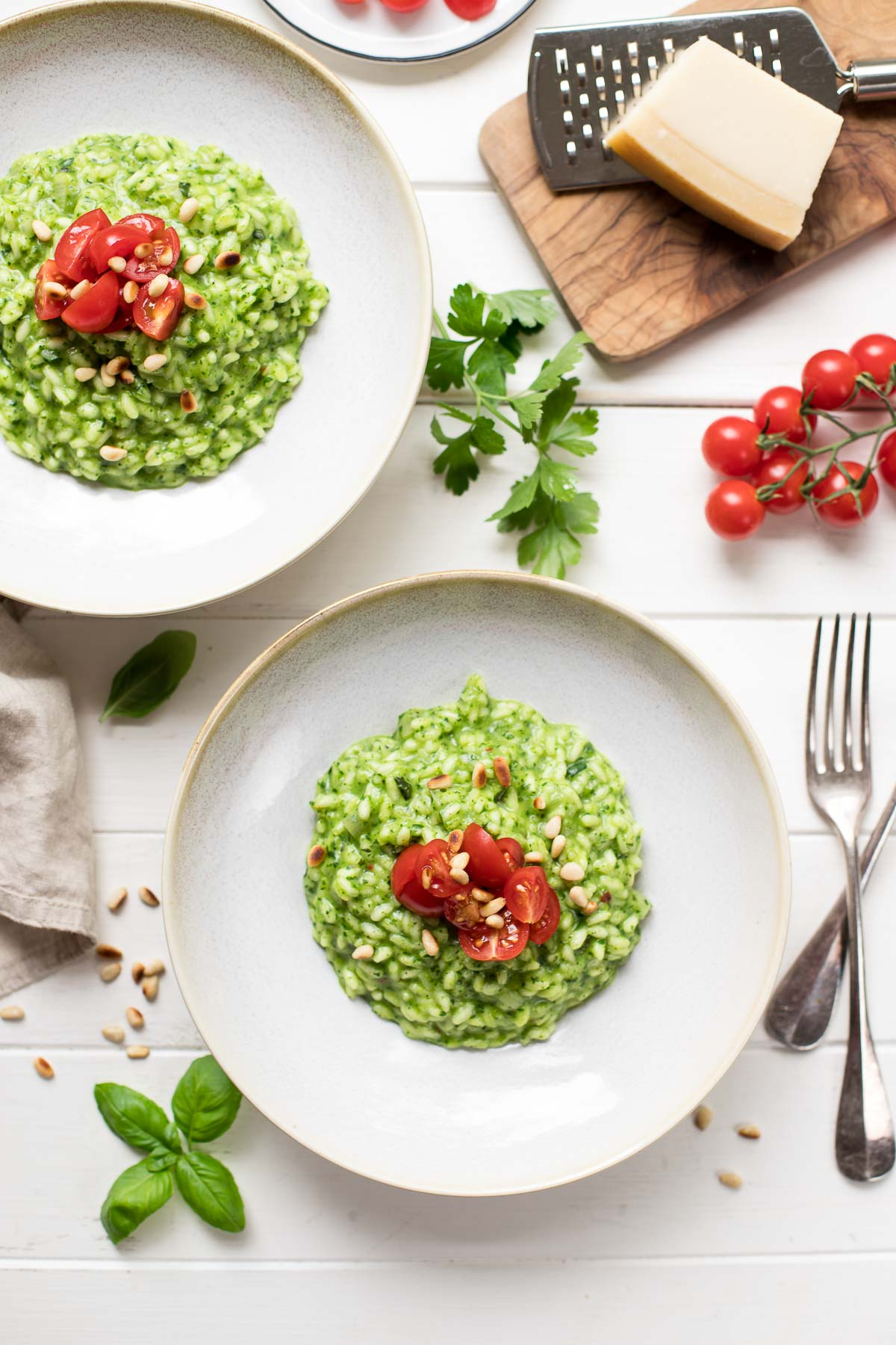 Spinat-Risotto Rezept mit Tomaten und Pinienkerne