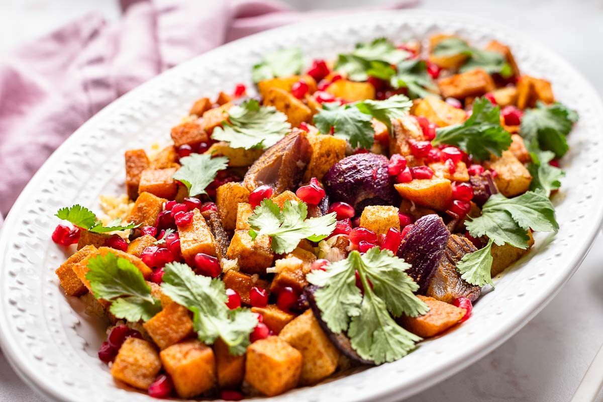 Roasted Sweet Potato and Pear Salad with Bulgur, pomegranate, herbs vegan recipe