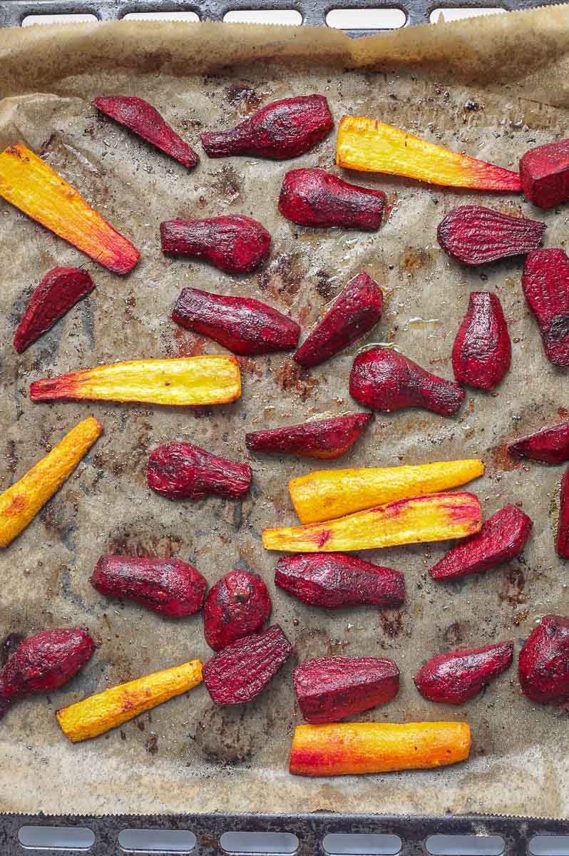 Oven roasted beetroot and carrots on baking sheet