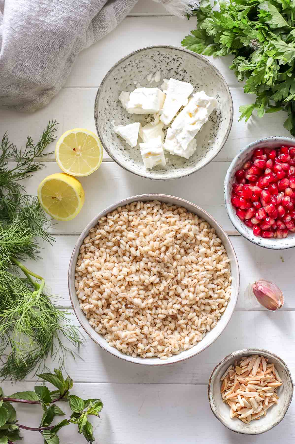 Ingredients for Pearl Barley Salad: Pomegranate, Almonds, Feta, Barley and Herbs
