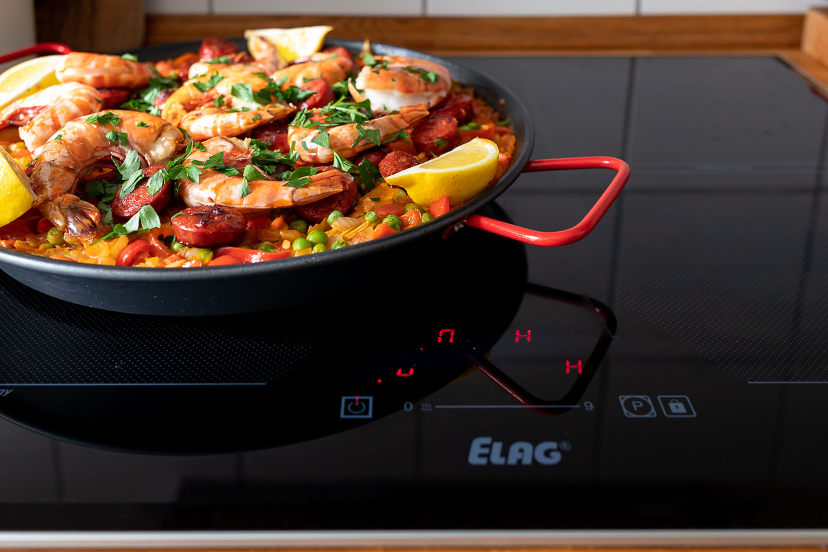 ELAG cooktop with Paella with Prawns and Chorizo