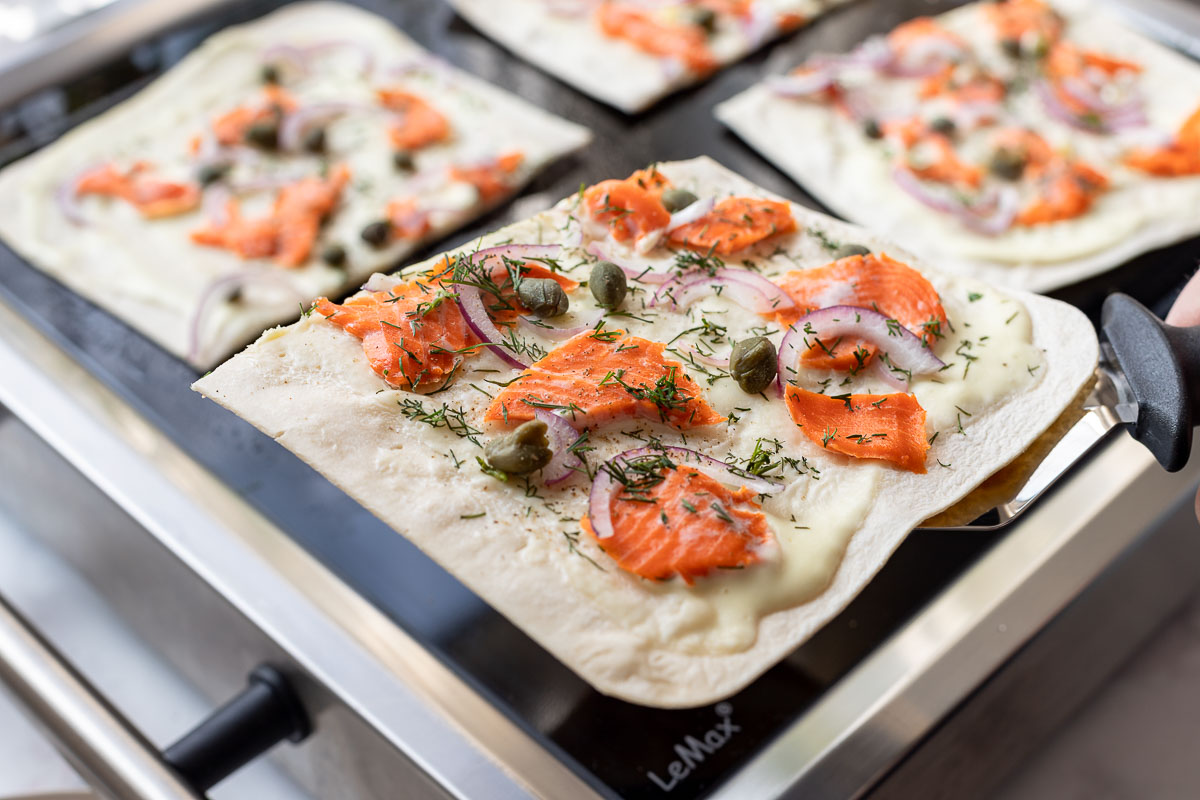 Tarte Flambée with Salmon (Flammkuchen) with capers, dill, red onion on LeMax Grill