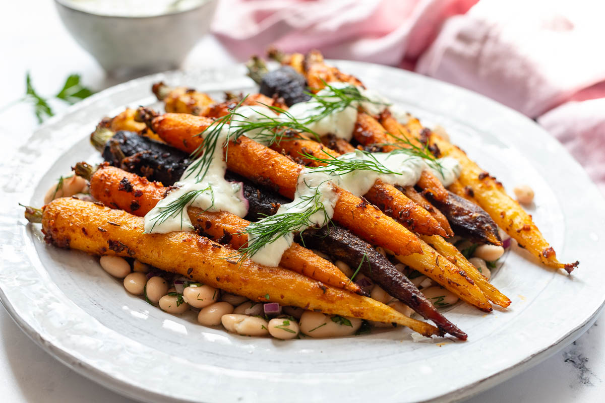 Roasted Carrots with Harissa, Butter Beans and Yoghurt Sauce